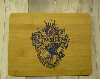 Harry Potter. Hogwarts house tablemats. Ravenclaw, Hufflepuff. Slytherin and Gryffindor. Set of 4.