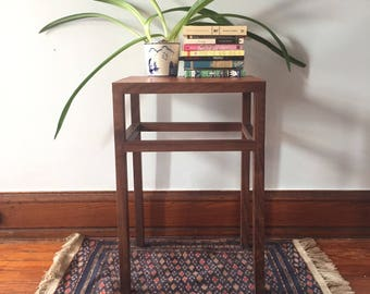 Claro Walnut side table with leather top and inlaid patches