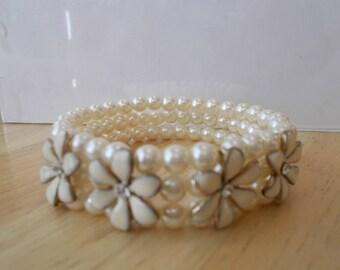 3 Row White Sea Shell Stretch Cuff Bracelet with Ecru Flowers and Clear Rhinestones