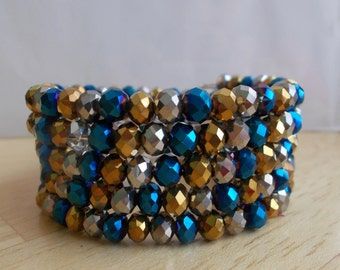 5 Row Memory Wire Cuff Bracelet made with Gold, Silver Blue and Purple Metallic crystal Beads