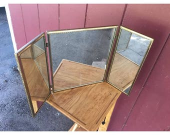 Vintage Mirror Tri Fold Out 3 Way Vanity Make Up Gold Toned Standing. It is 14 inches tall and about 24 inches wide when unfolded.