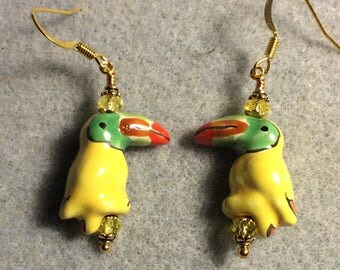 Yellow toucan bead earrings adorned with yellow Chinese crystal beads.