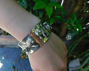 CAROL FELLEY sterling wild animal cuff bracelet, rare endangered species solid dimensional cuff.  Lion, Gorilla, Hippo dimensional animals.