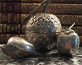 A set of three vintage Cambodian silver betel boxes
