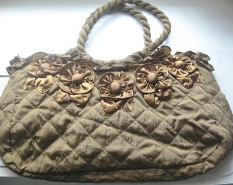 Handbag quilted lightweight easy to fold-beige material glossy polyester,adorned with flowers and ruffles zippered top,2 zippered pochets