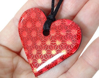 Necklace with metallic red heart pendant and resin polymer clay