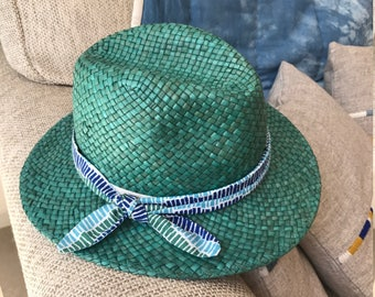 Green straw hat decorated with a headband