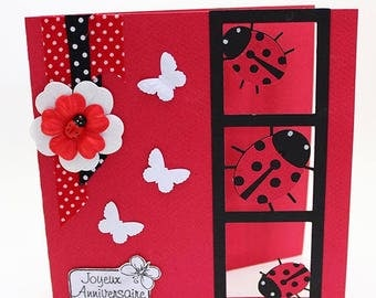 Red and black ladybugs birthday card and its pretty butterflies