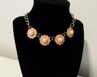 Orange metal flowers with pearl bead center