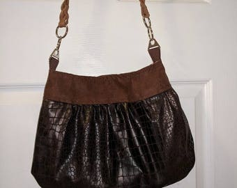 Brown and beige shoulder bag made of faux leather.