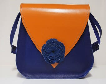 Dressed in blue and orange handbag