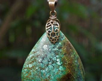 Turquoise pendant with bronze bail