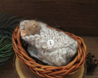 Miniature mouse in bed needle felting