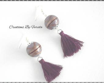 Earring with a pretty purple Pearl striped copper which is suspended from a small tassel
