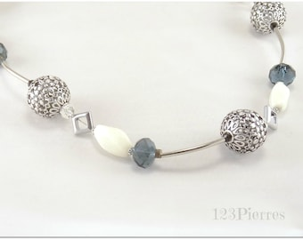 Asymmetrical necklace with white porcelain, diamond hematite, engraved metal and ink color crystal - An 123 Pierres jewel