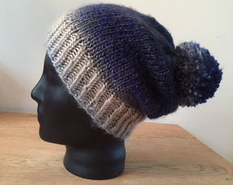 Blue handknitted hat with pompom