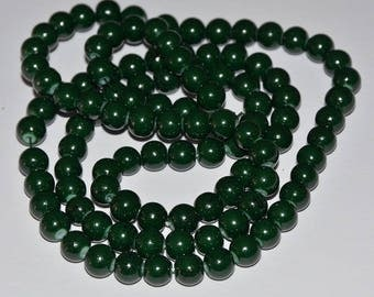 1 strand of 100 beads 8mm black, dark green glass