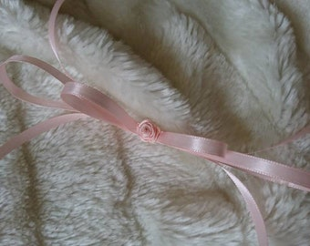 Neck loop made of satin ribbons with handmade rose