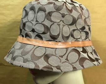 COACH Leatherware Monogram Bucket Hat