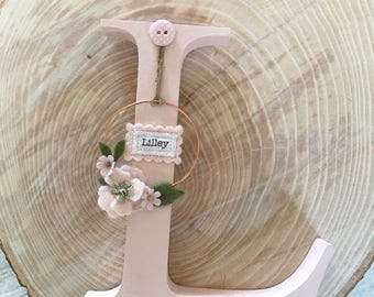 Personalised freestanding wooden initial with mini copper wreath detail