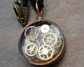 copper pipe pendant with antique watch parts set in jewellery grade resin