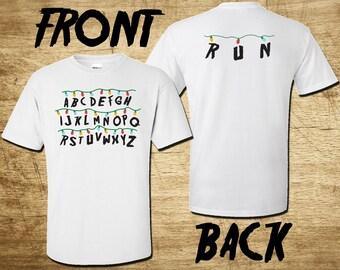 Stranger Things Christmas Alphabet Wall T-Shirt | Includes spelling RUN on the back | Demogorgon spells RUN | Available in Mens Womens Kids