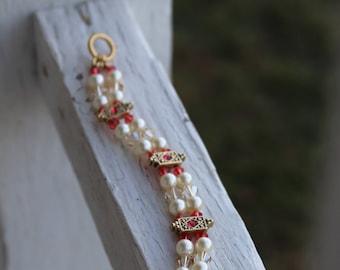 JBK 136 Pearl Bracelet with Orange Accents