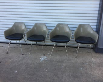 Set of four mid century modern fiberglass armchairs made by Burke, Inc