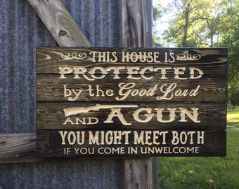 Carved This House Is Prtected By The Good Lord and A Gun sign - welcome sign - gun welcome sign