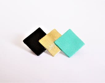 Pin 3 squares of black leather, gold and green neptune