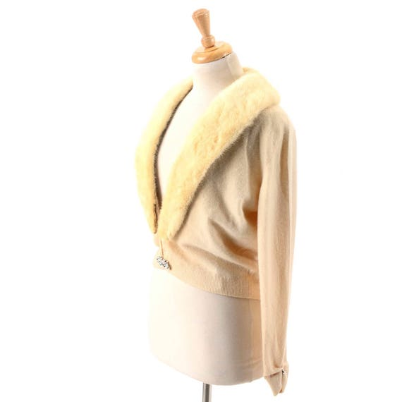 Vintage Bernard Altmann off-white cashmere sweater with faux fur collar and rhinestone clasp, 1950s.