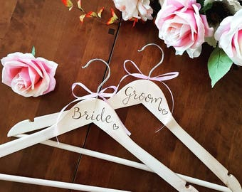 Bride and Groom Personalised Wooden coat hangers with the couple's name added. Beautiful, useable wedding gift using pyrography