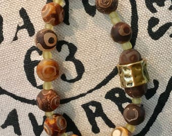 Handmade natural brown agate bracelet with amber glass beads and accented with a gold band