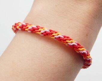 Kumihimo pink/orange/red tone adjustable bracelet