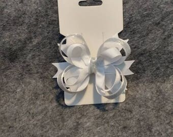 White  and silver sparkly hair bow.