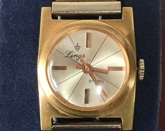Lovely Ladies Vintage LINGS 21 Prix on Bark textured Strap marked Ct 13 750                 .