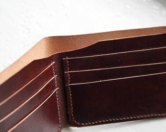 Classic Bifold Leather wallet made of vegetable tanned Italian leather. Hand stitched and hand dyed leather wallet with 6 slots for cards