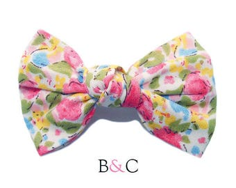 Hair bow tied Liberty Blue Rose.