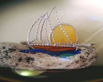 stained glass.boat. driftwood