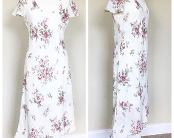 Floral day dress with assymetrical hem. Women's US size 12.