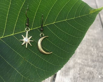 moon & stars asymmetrical earrings.