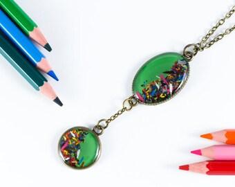 "Hanging green ""Chromatic"" pencil shavings"