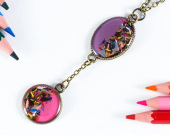 """Hanging purple and pink """"Chromatic"""" pencil shavings"""