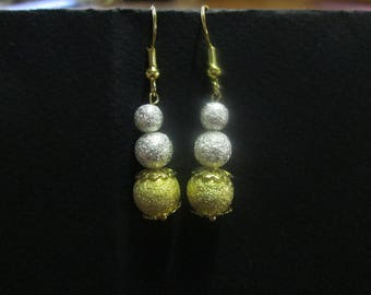 Earring in gold and silver Stardust beads