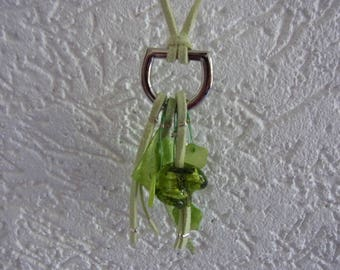 green long necklace / pale green suede pendant with metal ring and charms / long necklace