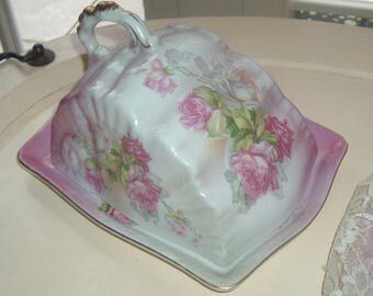 Covered cheese dish with roses