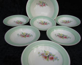 A lovely set of six vintage bowls and a serving dish.