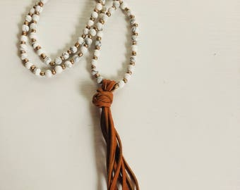 SALE- white with leather tassel