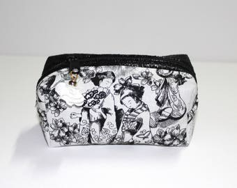 Makeup or nail them black and white distressed leather and geisha motif