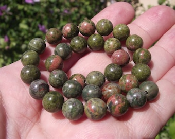 4 ROUND MULTICOLORED 8 MM UNAKITE BEADS.